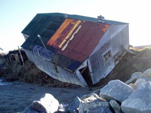 House falling over in Shishmaref, Alaska