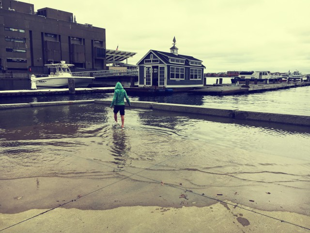 Flooding at Long Wharf during the King Tides in mid-November gave Bostonians a preview of climate change. Photo by Gwendolyn Schanker; filter by BeFunky.